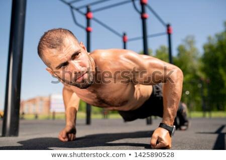 Stock photo: Push-ups over ground