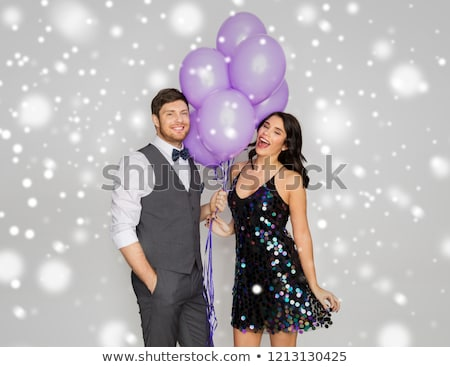 Stock photo: happy couple with ultra violet balloons at party