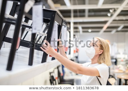 woman shopping for furniture in a furniture store Stock photo © Lopolo