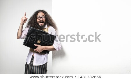 Cheerful nerd holding a brief case - standing next to the empty  Stock photo © majdansky