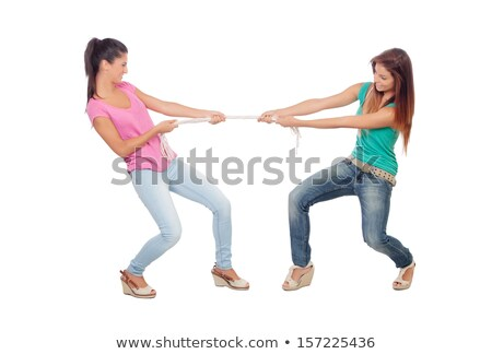 A couple play tug-of-war with rope. Stock photo © Lopolo