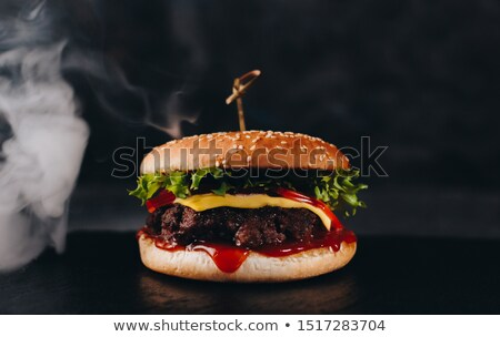 Fresh organic beef burger with cheese  and sauce with vegetables on wooden board. Macro Stock photo © DenisMArt
