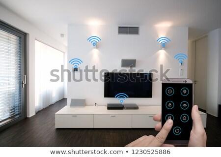 Smart house controlled with smartphone app Stock photo © jossdiim