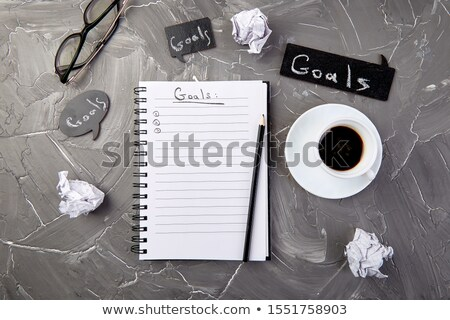 Goals as memo on notebook with idea, crumpled paper, cup of coffee  Stock photo © Illia
