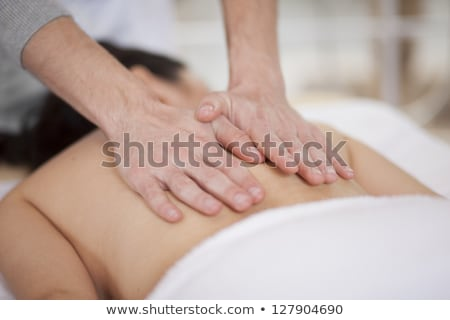 Therapist Massaging Male Customer's Back At Spa Stock photo © AndreyPopov