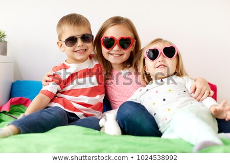smiling preteen girl with heart shaped sunglasses Stock photo © dolgachov