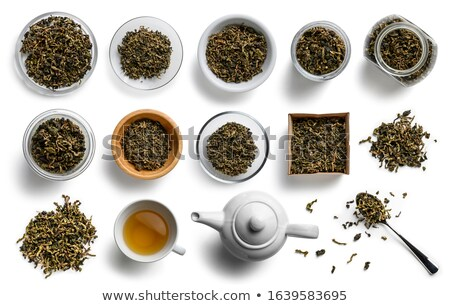Lotus tea and accessories top view on white background Stock photo © butenkow