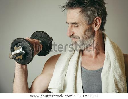 Mature Man Exercise With Dumbbells On Grey Background Stock photo © Jasminko