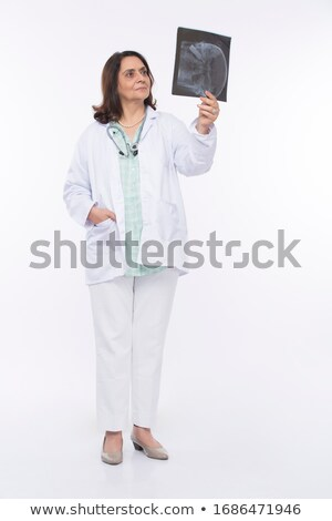 female doctor checking xray image isolated on white background stock photo © nobilior
