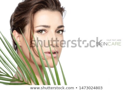 closeup portrait of young beautiful woman with green leaf as copy space stock photo © zurijeta