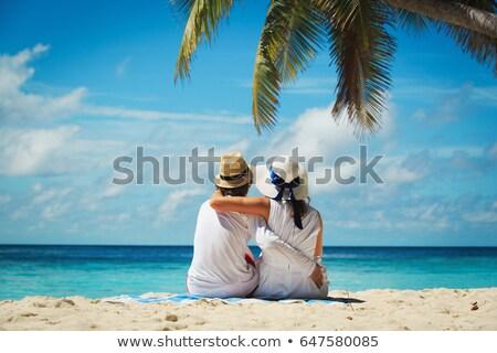 пары наслаждаться пляж цветы девушки человека Сток-фото © vichie81