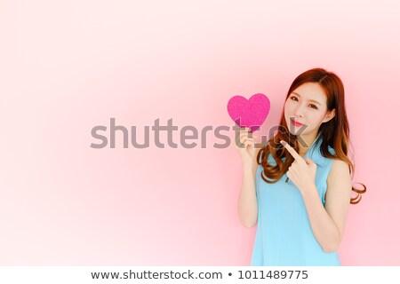 beautiful woman presenting red heart stock photo © rob_stark