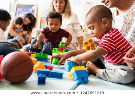 Fiatal gyermek játszik színes építőkockák fehér Stock fotó © gewoldi