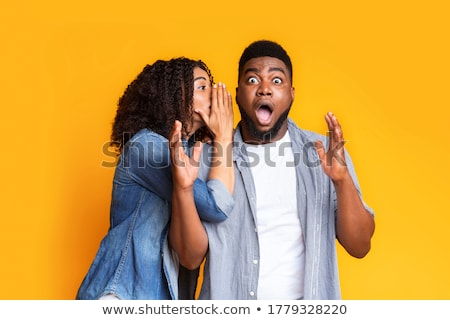 Girl sharing secrets with her boyfriend Stock photo © stockyimages