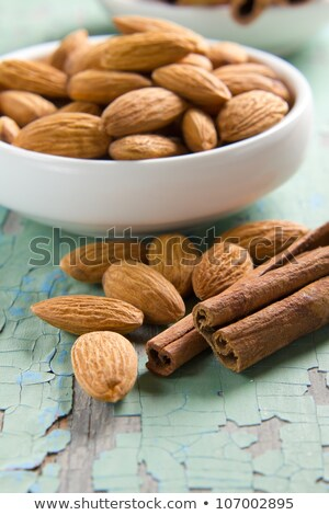 Aroma spices. Cinnamon and almonds on the vintage wooden surface. Stock photo © yelenayemchuk