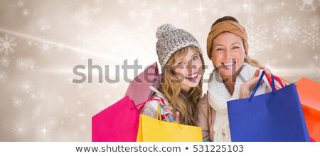 blond with shopping bags and snowflakes stock photo © dolgachov