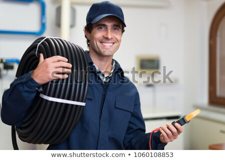 Electricians wiring a white and blue building Stock photo © photography33