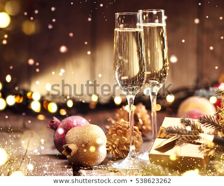 champagne glasses and christmas decor stock photo © karandaev