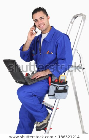 Electrician chatting to customer on the phone Stock photo © photography33
