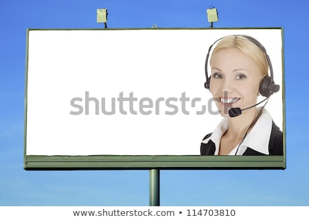 Pretty girl with headset smiling to you from street billboard Stock photo © Nobilior