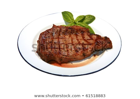 hot fresh grilled boneless rib eye steak isolated on white with barbecue grill marks in the meat stock photo © ozaiachin