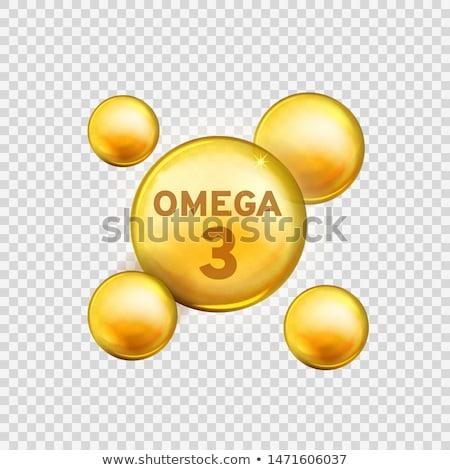 Omega3 ujjak tart omega 3 halolaj kapszula Stock fotó © Stocksnapper