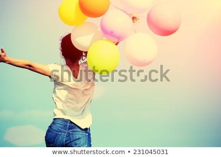 jovem · feliz · mulher · balão · rosa - foto stock © rosipro