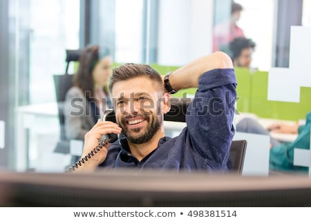 Businessman on two telephone calls Stock photo © photography33