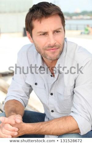 pensive man sat riverside Stock photo © photography33