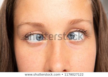Niespodzianką portret piękna młoda kobieta patrząc wskazówka Zdjęcia stock © eldadcarin