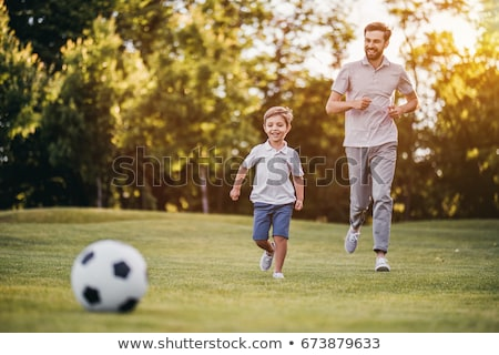 Stock photo: father play with son in park