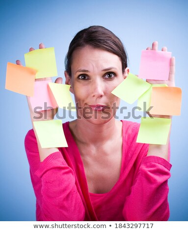 Businesswoman with multi task pink notes Stock photo © lunamarina