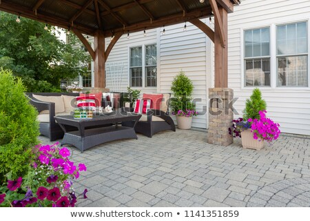 brick patio and pillar with flowers stock photo © ozgur