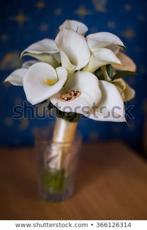 yellow calla lilies and  wedding rings Stock photo © taden
