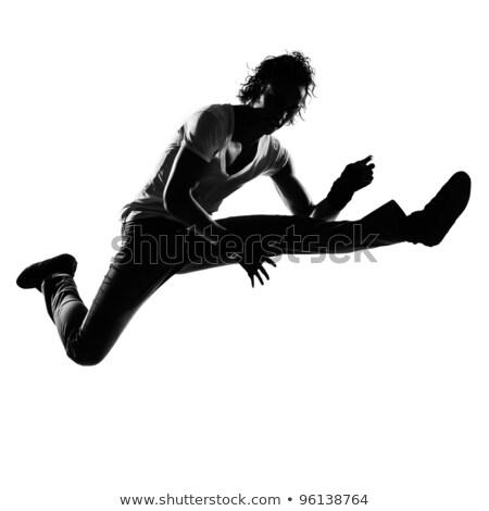 Adam dansçı atlama yalıtılmış beyaz spor Stok fotoğraf © stepstock
