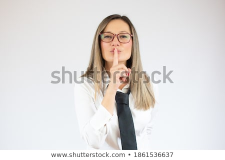 Silence gesture by young corporate lady Stock photo © stockyimages