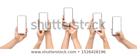 Set of hands using mobile devices Stock photo © czaroot