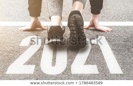Year numbers on athletics running track Stock photo © stevanovicigor