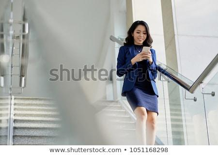 boldog · üzletasszony · okostelefon · kollégák · nő · internet - stock fotó © hasloo