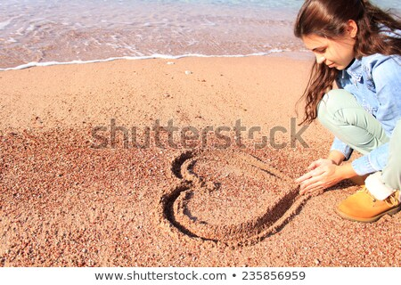 Hand drawing heart in the sand Stock photo © bigandt