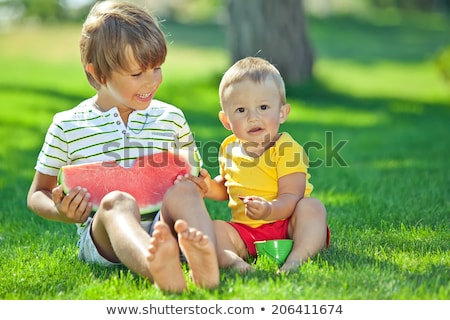 group of babies eating watermelon outdoors stock photo © nejron
