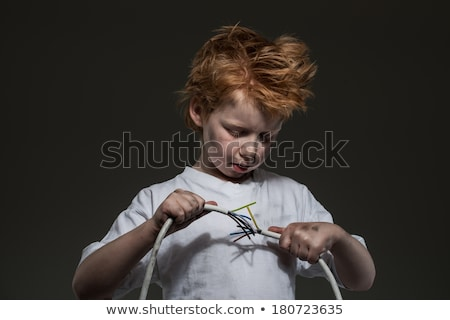 Little redhead bad boy with wires Stock photo © Nejron