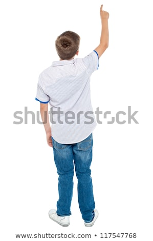 rear view of a school boy over white background pointing upwards stock photo © ashumskiy