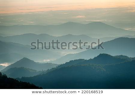 Simples camadas pôr do sol enfumaçado montanha parque Foto stock © alex_grichenko