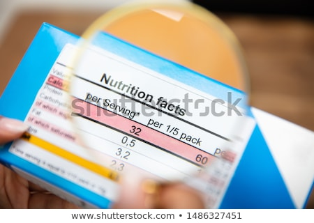 energy labels with magnifying glass stock photo © muuraa