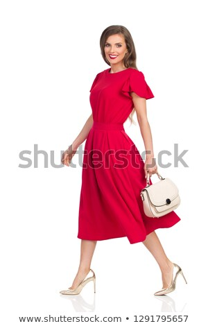Smiling Slim Woman in Red Dress Holding Purse Stock photo © dash
