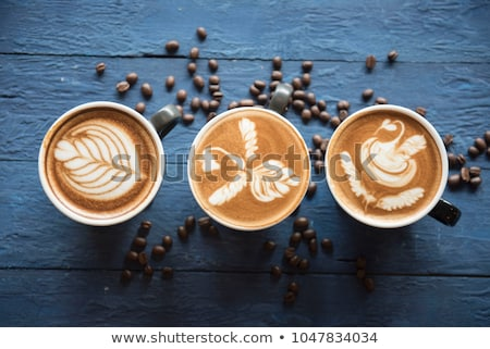 latte art in mug stock photo © yanukit