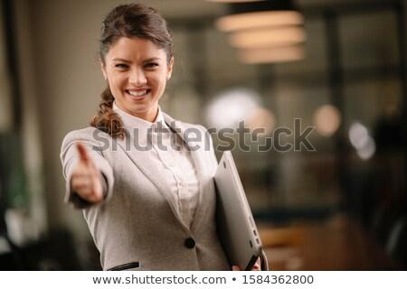 feliz · mujer · de · negocios · apretón · de · manos · socio · reunión - foto stock © iko