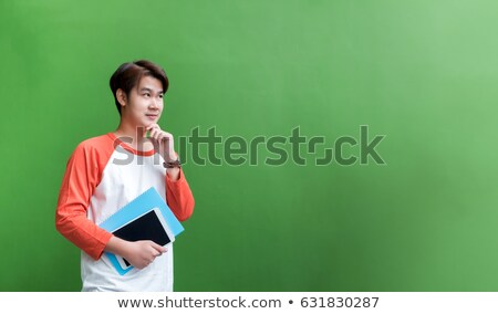 Young asian caucasian business man holding a book Stock photo © HASLOO