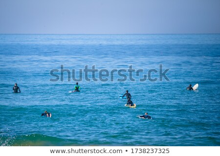 Surfers on the water Stock photo © homydesign